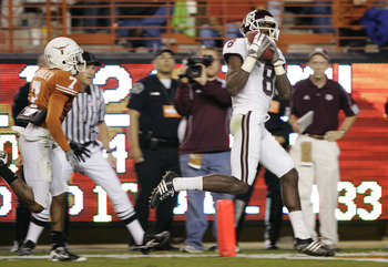 AUSTIN, TX - NOVEMBER 27: Wide receiver Jeff Fuller #8 of the Texas A&M Aggies pulls in a touchdown pass against cornerback Deon Beasley #7 of the Texas Longhorns in the fourth quarter at Darrell K Royal-Texas Memorial Stadium November 27, 2008 in Austin,