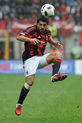 MILAN, ITALY - MARCH 13:  Gennaro Ivan Gattuso of AC Milan in action during the Serie A match between AC Milan and AS Bari at Stadio Giuseppe Meazza on March 13, 2011 in Milan, Italy.  (Photo by Valerio Pennicino/Getty Images)