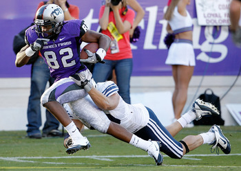 FORT WORTH, TX - OCTOBER 16:  Wide receiver Josh Boyce #82 of the TCU Horned Frogs scores a touchdown against line backer Jadon Wagner #49 the BYU Cougars at Amon G. Carter Stadium on October 16, 2010 in Fort Worth, Texas.  TCU beat BYU 31-3.  (Photo by T