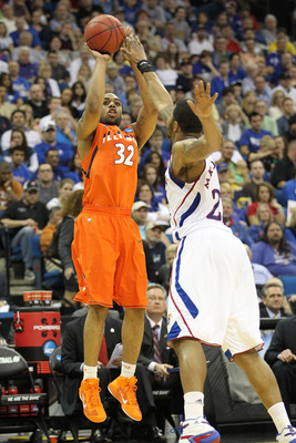 TULSA, OK - MARCH 20:  Demetri McCamey #32 of the Illinois Fighting Illini takes a shot over Markieff Morris #21 of the Kansas Jayhawks during the third round of the 2011 NCAA men's basketball tournament at BOK Center on March 20, 2011 in Tulsa, Oklahoma.