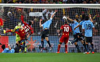 JOHANNESBURG, SOUTH AFRICA - JULY 02:  Luis Suarez of Uruguay handles the ball on the goal line, for which he is sent off, during the 2010 FIFA World Cup South Africa Quarter Final match between Uruguay and Ghana at the Soccer City stadium on July 2, 2010