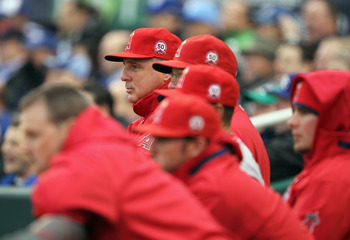 KANSAS CITY, MO - MARCH 31:  Manager Mike Scioscia #14 of the Los Angeles Angels of Anaheim watches from the dugout during the opening day game against the Kansas City Royals at Kauffman Stadium on March 31, 2011 in Kansas City, Missouri.  (Photo by Jamie