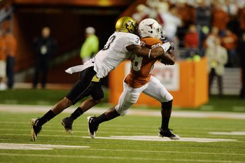 AUSTIN, TX - OCTOBER 10:  Running back Fozzy Whittaker #28 of the Texas Longhorns carries the ball against cornerback Jimmy Smith #3 of the Colorado Buffaloes on October 10, 2009 at Darrell K Royal-Texas Memorial Stadium in Austin, Texas.  Texas won 38-14