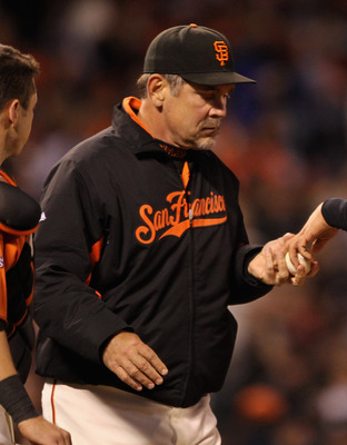 SAN FRANCISCO, CA - APRIL 22: Manager Bruce Bochy takes Madison Bumgarner #40 of the San Francisco Giants out of the game after he gave up four runs to the Atlanta Braves in the third inning at AT&T Park on April 22, 2011 in San Francisco, California.  (P