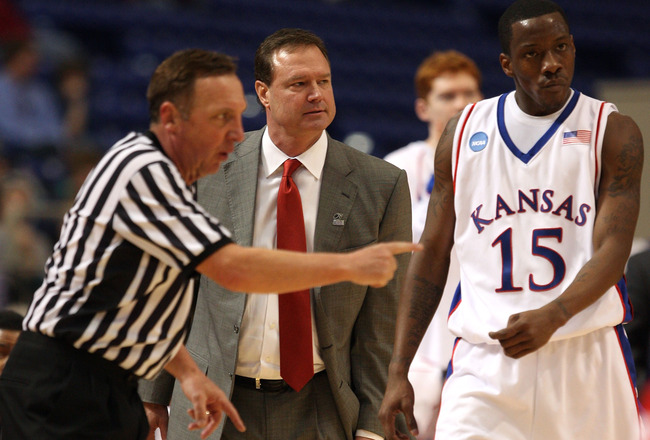 MINNEAPOLIS - MARCH 22:  Head coach Bill Self and Tyshawn Taylor #15 of the Kansas Jayhawks look on as the referee makes a call against the Dayton Flyers during the second round of the NCAA Division I Men's Basketball Tournament at the Hubert H. Humphrey