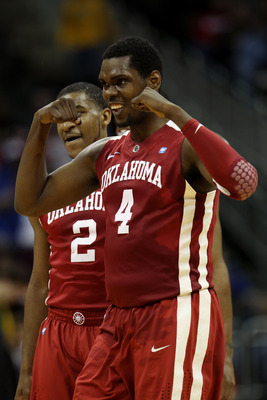 KANSAS CITY, MO - MARCH 09:  Andrew Fitzgerald #4 of the Oklahoma Sooners reacts to a play against the Baylor Bears during their game in the first round of the 2011 Phillips 66 Big 12 Men's Basketball Tournament at Sprint Center on March 9, 2011 in Kansas