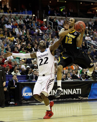 WASHINGTON - MARCH 17:  Marcus Denmon #12 of the Missouri Tigers goes up for a shot against Rashad Bishop #22 of the Cincinnati Bearcats during the second round of the 2011 NCAA men's basketball tournament at the Verizon Center on March 17, 2011 in Washin