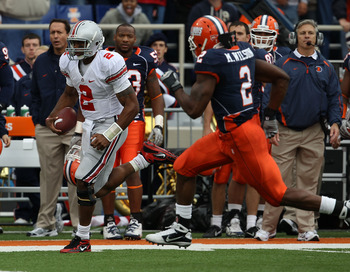 CHAMPAIGN, IL - OCTOBER 02: Terrelle Pryor #2 of the Ohio State Buckeyes runs for a first down as Martez Wilson #2 of the Illinois Fighting Illini pursues at Memorial Stadium on October 2, 2010 in Champaign, Illinois. Ohio State defeated Illinois 24-13. (