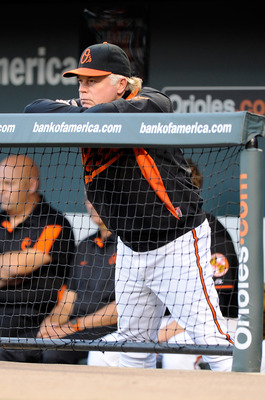 BALTIMORE, MD - APRIL 20:  Manager Buck Showalter of the Baltimore Orioles watches the game against the Minnesota Twins at Oriole Park at Camden Yards on April 20, 2011 in Baltimore, Maryland.  (Photo by Greg Fiume/Getty Images)