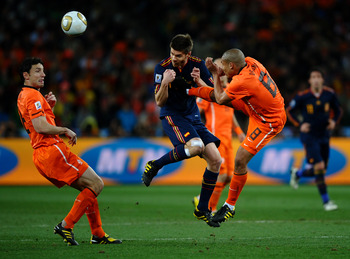 JOHANNESBURG, SOUTH AFRICA - JULY 11:  Nigel De Jong of the Netherlands tackles Xabi Alonso of Spain during the 2010 FIFA World Cup South Africa Final match between Netherlands and Spain at Soccer City Stadium on July 11, 2010 in Johannesburg, South Afric