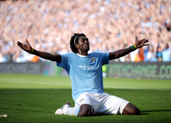 MANCHESTER, ENGLAND - SEPTEMBER 12:  Emmanuel Adebayor of Manchester City celebrates in front of the Arsenal fans after scoring during the Barclays Premier League match between Manchester City and Arsenal at the City of Manchester Stadium on September 12,
