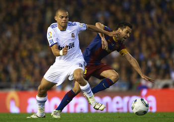 VALENCIA, BARCELONA - APRIL 20: Xavi Hernandez (r) of Barcelona and Pepe of Real Madrid competes for the ball during the Copa del Rey final match between Real Madrid and Barcelona at Estadio Mestalla on April 20, 2011 in Valencia, Spain.  (Photo by Manuel