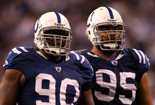 INDIANAPOLIS, IN - JANUARY 08:  (L-R) Dan Muir #90 and Fili Moala #95 of the Indianapolis Colts look on against the New York Jets during their 2011 AFC wild card playoff game at Lucas Oil Stadium on January 8, 2011 in Indianapolis, Indiana. The Jets won 1