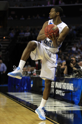 CHARLOTTE, NC - MARCH 18:  Dexter Strickland #1 of the North Carolina Tar Heels looks to save the ball in the first half while taking on the Long Island Blackbirds during the second round of the 2011 NCAA men's basketball tournament at Time Warner Cable A