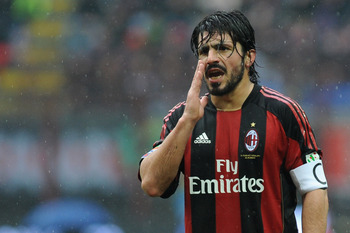 MILAN, ITALY - MARCH 13:  Gennaro Ivan Gattuso of AC Milan gestures during the Serie A match between AC Milan and AS Bari at Stadio Giuseppe Meazza on March 13, 2011 in Milan, Italy.  (Photo by Valerio Pennicino/Getty Images)