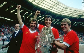 1979:  (Left to right) Graeme Souness, Alan Hansen and Kenny Dalglish of Liverpool hold the trophy after the Charity Shield match against Arsenal at Wembley Stadium in London. Liverpool won the match 3-1. \ Mandatory Credit: Allsport UK /Allsport