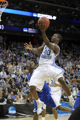 NEWARK, NJ - MARCH 27:  Harrison Barnes #40 of the North Carolina Tar Heels goes for a layup against Doron Lamb #20 of the Kentucky Wildcats during the east regional final of the 2011 NCAA men's basketball tournament at Prudential Center on March 27, 2011
