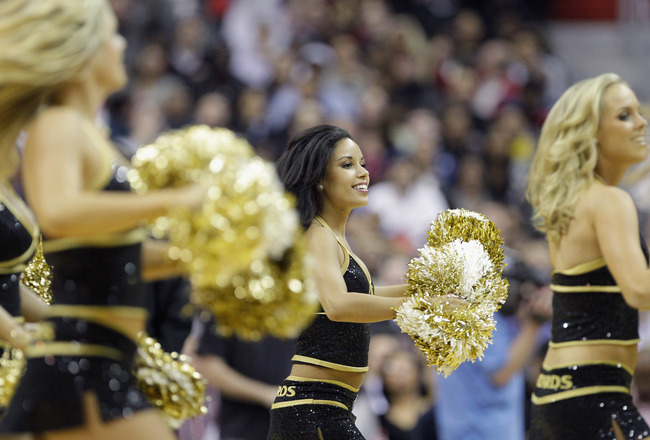 WASHINGTON, DC - MARCH 30: Members of the Washington Wizards Girls preform during the second half of the Washington Wizards and Miami Heat game at the Verizon Center on March 30, 2011 in Washington, DC. NOTE TO USER: User expressly acknowledges and agrees