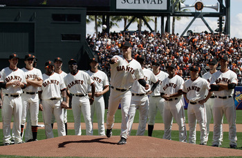 SAN FRANCISCO, CA - APRIL 08:  Matt Cain #18 of the San Francisco Giants throws out the first pitch before the start of the opening day game against the St. Louis Cardinals at AT&amp;T Park on April 8, 2011 in San Francisco, California.  (Photo by Marcio Jose