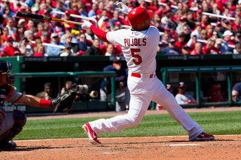 ST. LOUIS, MO - APRIL 21: Albert Pujols #5 of the St. Louis Cardinals hits a two-run home run against the Washington Nationals at Busch Stadium on April 21, 2011 in St. Louis, Missouri.  (Photo by Dilip Vishwanat/Getty Images)