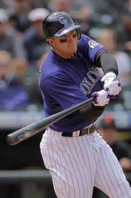 DENVER, CO - APRIL 20:  Troy Tulowitzki #2 of the Colorado Rockies hits a double in the second inning against the San Francisco Giants at Coors Field on April 20, 2011 in Denver, Colorado.  (Photo by Doug Pensinger/Getty Images)