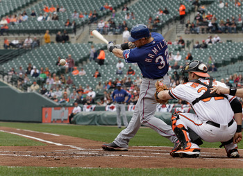 BALTIMORE, MD - APRIL 10:  Josh Hamilton #32 of the Texas Rangers at the plate as catcher Matt Wieters #32 of the Baltimore Orioles looks on at Oriole Park at Camden Yards on April 10, 2011 in Baltimore, Maryland.  (Photo by Rob Carr/Getty Images)