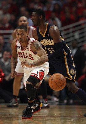 CHICAGO, IL - APRIL 18: Derrick Rose #1 of the Chicago Bulls moves to a loose ball next to Roy Hibbert #55 of the Indiana Pacer defense in Game Two of the Eastern Conference Quarterfinals in the 2011 NBA Playoffs at the United Center on April 18, 2011 in