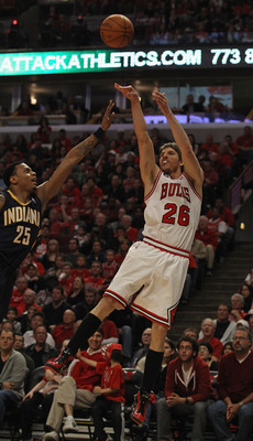 CHICAGO, IL - APRIL 16: Kyle Korver #26 of the Chicago Bulls puts up a shot over Brandon Rush #25 of the Indiana Pacers in Game One of the Eastern Conference Quarterfinals in the 2011 NBA Playoffs at the United Center on April 16, 2011 in Chicago, Illinoi