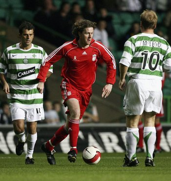 GLASGOW, UNITED KINGDOM - OCTOBER 04: Darren Jackson and Murdo MacLeod (R) of Celtic Legends attempt to stop Steven McManaman of Liverpool Legends during the charity chalenge match at Celtic Park on October 4, 2006 in Glasgow, Scotland.  (Photo by Jeff J