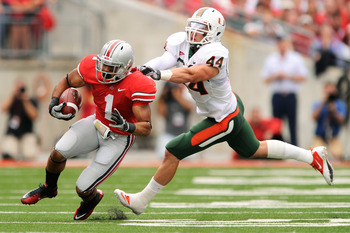 COLUMBUS, OH - SEPTEMBER 11:  Colin McCarthy #44 of the Miami Hurricanes attempts to tackle Dan Herron #1 of the Ohio State Buckeyes at Ohio Stadium on September 11, 2010 in Columbus, Ohio.  (Photo by Jamie Sabau/Getty Images)