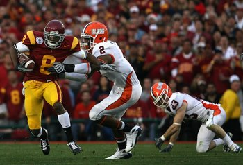 PASADENA, CA - JANUARY 01:  Wide receiver Ronald Johnson #8 of the USC Trojans returns a kick off for 14 yards under pressure from Martez Wilson #2 of the Illinois Fighting Illini during the Rose Bowl presented by Citi at the Rose Bowl on January 1, 2008