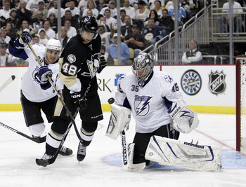 PITTSBURGH, PA - APRIL 13:  Dwayne Roloson #35 of the Tampa Bay Lightning makes a save as Tyler Kennedy #48 of the Pittsburgh Penguins attempts to screen the goaltender in Game One of the Eastern Conference Quarterfinals during the 2011 NHL Stanley Cup Pl