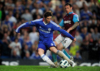 LONDON, ENGLAND - APRIL 23:  Fernando Torres of Chelsea scores his team's second goal and the first of his Chelsea career during the Barclays Premier League match between Chelsea and West Ham United at Stamford Bridge on April 23, 2011 in London, England.