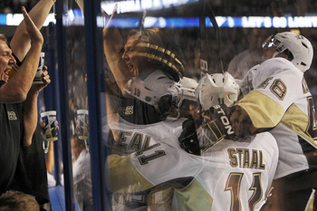 TAMPA, FL - APRIL 20: James Neal #18 of the Pittsburgh Penguins is swarmed by teammates after scoring the game winning goal in the second overtime period against the Tampa Bay Lightning in Game Four of the Eastern Conference Quarterfinals during the 2011