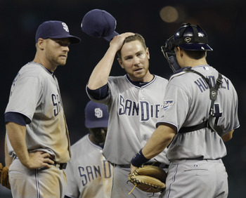 HOUSTON - APRIL 14:  Pitcher Dustin Moseley of the San Diego Padres,center, wipes his head as he talks with catcher Nick Hundley, right, and Chase Headley , left  at Minute Maid Park on April 14, 2011 in Houston, Texas.  (Photo by Bob Levey/Getty Images)
