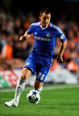 LONDON, ENGLAND - APRIL 06:  John Terry of Chelsea runs with the ball during the UEFA Champions League quarter final first leg match between Chelsea and Manchester United at Stamford Bridge on April 6, 2011 in London, England.  (Photo by Mike Hewitt/Getty