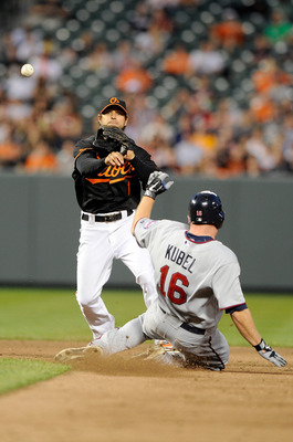 BALTIMORE, MD - APRIL 20:  Brian Roberts #1 of the Baltimore Orioles forces out Jason Kubel #16 of the Minnesota Twins to start a double play at Oriole Park at Camden Yards on April 20, 2011 in Baltimore, Maryland.  (Photo by Greg Fiume/Getty Images)