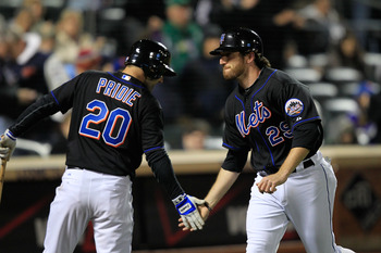 NEW YORK, NY - APRIL 22:  Ike Davis #29 of the New York Mets is congratulated for his two-run homer in the seventh inning by teammate Jason Pridie #20 against the Arizona Diamondbacks at Citi Field on April 22, 2011 in the Flushing neighborhood of the Que