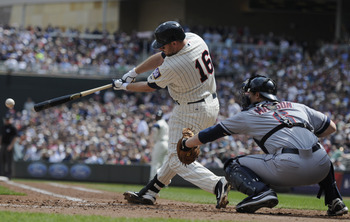 MINNEAPOLIS, MN - APRIL 24: Jason Kubel #16 of the Minnesota Twins hits a single as Lou Marson #6 of the Cleveland Indians defends home plate during the third inning of their game on April 24, 2011 at Target Field in Minneapolis, Minnesota. Twins defeated
