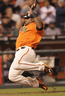 SAN FRANCISCO, CA - APRIL 22:  Pablo Sandoval #48 of the San Francisco Giants scores on a ground out by Pat Burrell #5 in the seventh inning of their game against the Atlanta Braves at AT&T Park on April 22, 2011 in San Francisco, California.  (Photo by E