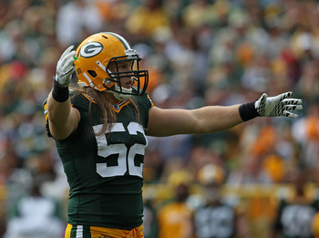 GREEN BAY, WI - SEPTEMBER 19: Clay Matthews #52 of the Green Bay Packers encourages the crowd during a game against the Buffalo Bills at Lambeau Field on September 19, 2010 in Green Bay, Wisconsin. The Packers defeated the Bills 34-7.  (Photo by Jonathan