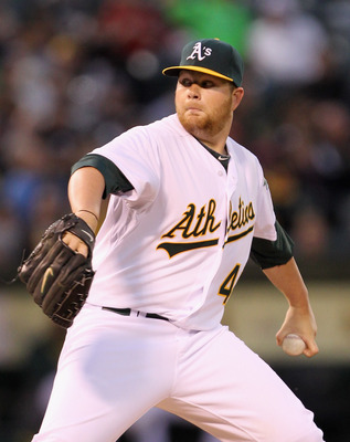 OAKLAND, CA - APRIL 19:  Brett Anderson #49 of the Oakland Athletics pitches against the Boston Red Sox at Oakland-Alameda County Coliseum on April 19, 2011 in Oakland, California.  (Photo by Ezra Shaw/Getty Images)