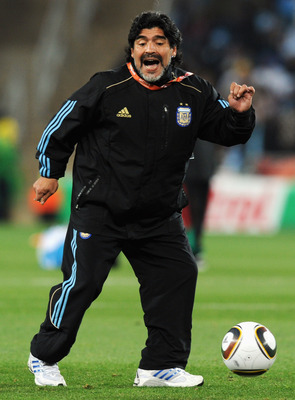 JOHANNESBURG, SOUTH AFRICA - JUNE 27:  Diego Maradona head coach of Argentina controls the ball during the warm up ahead of the 2010 FIFA World Cup South Africa Round of Sixteen match between Argentina and Mexico at Soccer City Stadium on June 27, 2010 in