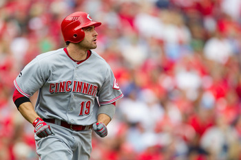 ST. LOUIS, MO - APRIL 23: Joey Votto #19 of the Cincinnati Reds watches his two-run home run leave the park against the St. Louis Cardinals at Busch Stadium on April 23, 2011 in St. Louis, Missouri.  (Photo by Dilip Vishwanat/Getty Images)