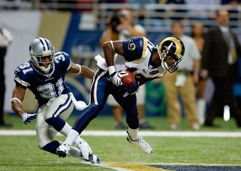 ST. LOUIS - OCTOBER 19:  Donnie Avery #17 of the St. Louis Rams holds on to the ball while covered by Mike Jenkins #31 of the Dallas Cowboys during their NFL game at Edward Jones Dome on October 19, 2008 in St. Louis, Missouri.  The Rams defeated the Cowb
