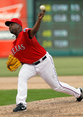 ARLINGTON, TX - APRIL 01:  Darren Oliver #28 of the Texas Rangers pitches against the Boston Red Sox on Opening Day at Rangers Ballpark in Arlington on April 1, 2011 in Arlington, Texas.  (Photo by Tom Pennington/Getty Images)