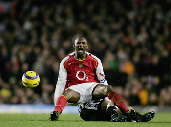 LONDON - JANUARY 23: Patrick Vieira of Arsenal is tackled and fouled by Lee Bowyer of Newcastle, during the Barclays Premiership match between Arsenal and Newcastle United at Highbury on January 23, 2005 in London, England.  (Photo by Ben Radford/Getty Im