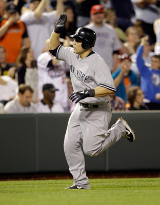 BALTIMORE, MD - APRIL 23:  Russell Martin #55 of the New York Yankees after hitting a solo homerun during the eighth inning against the Baltimore Orioles at Oriole Park at Camden Yards on April 23, 2011 in Baltimore, Maryland.  (Photo by Rob Carr/Getty Im