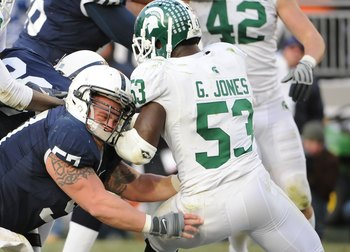 STATE COLLEGE - NOVEMBER 22:  A.Q. Shipley #57 of the Penn State Nittany Lions blocks Greg Jones #53 of the Michigan State Spartans on November 22, 2008 at Beaver Stadium in State College, Pennsylvania.  (Photo by Joe Sargent/Getty Images)