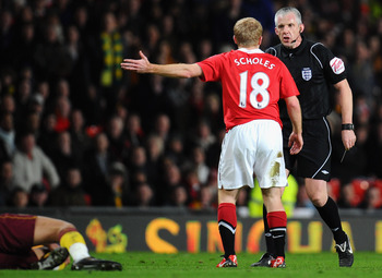 MANCHESTER, ENGLAND - MARCH 12:  Paul Scholes of Manchester United argues with referee Chris Foy during the FA Cup sponsored by E.On Sixth Round match between Manchester United and Arsenal at Old Trafford on March 12, 2011 in Manchester, England.  (Photo